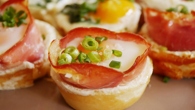 Mini yorkshire pudding cups filled with egg bacon and spring onions