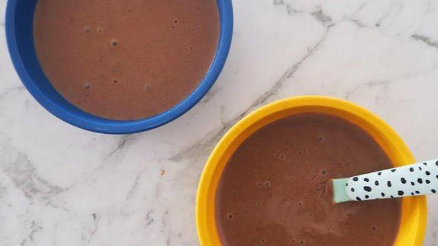 Colorful pots of creamy chocolate custard