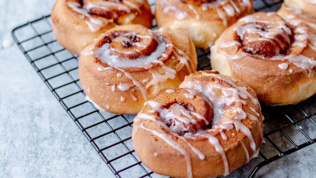 Golden brown swirls of cinnamon rolls drizzled in white icing