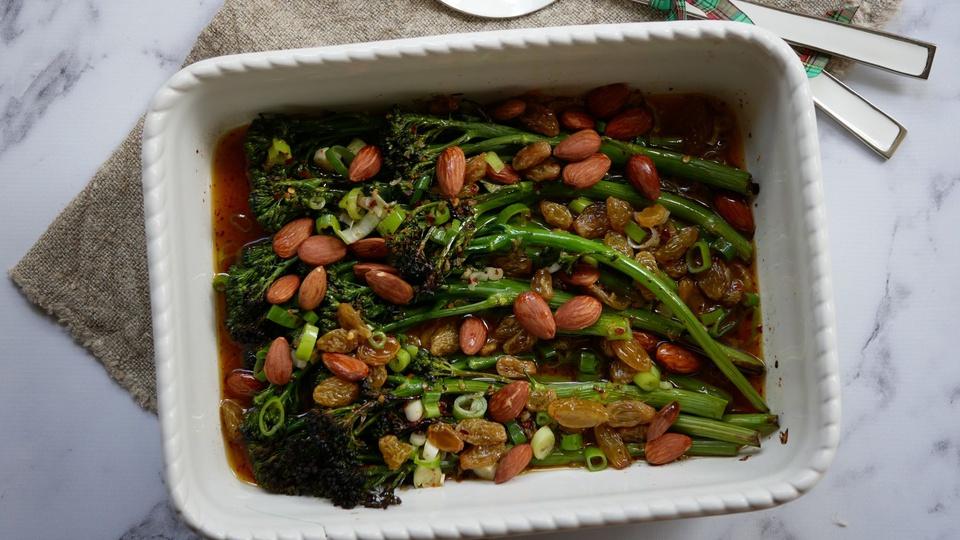 Charred broccolini with scallions whole almonds and brown raisin vinaigrette
