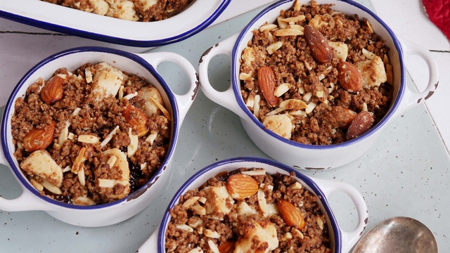 Individual pots of nutty christmas crumble with almonds coconut marzipan