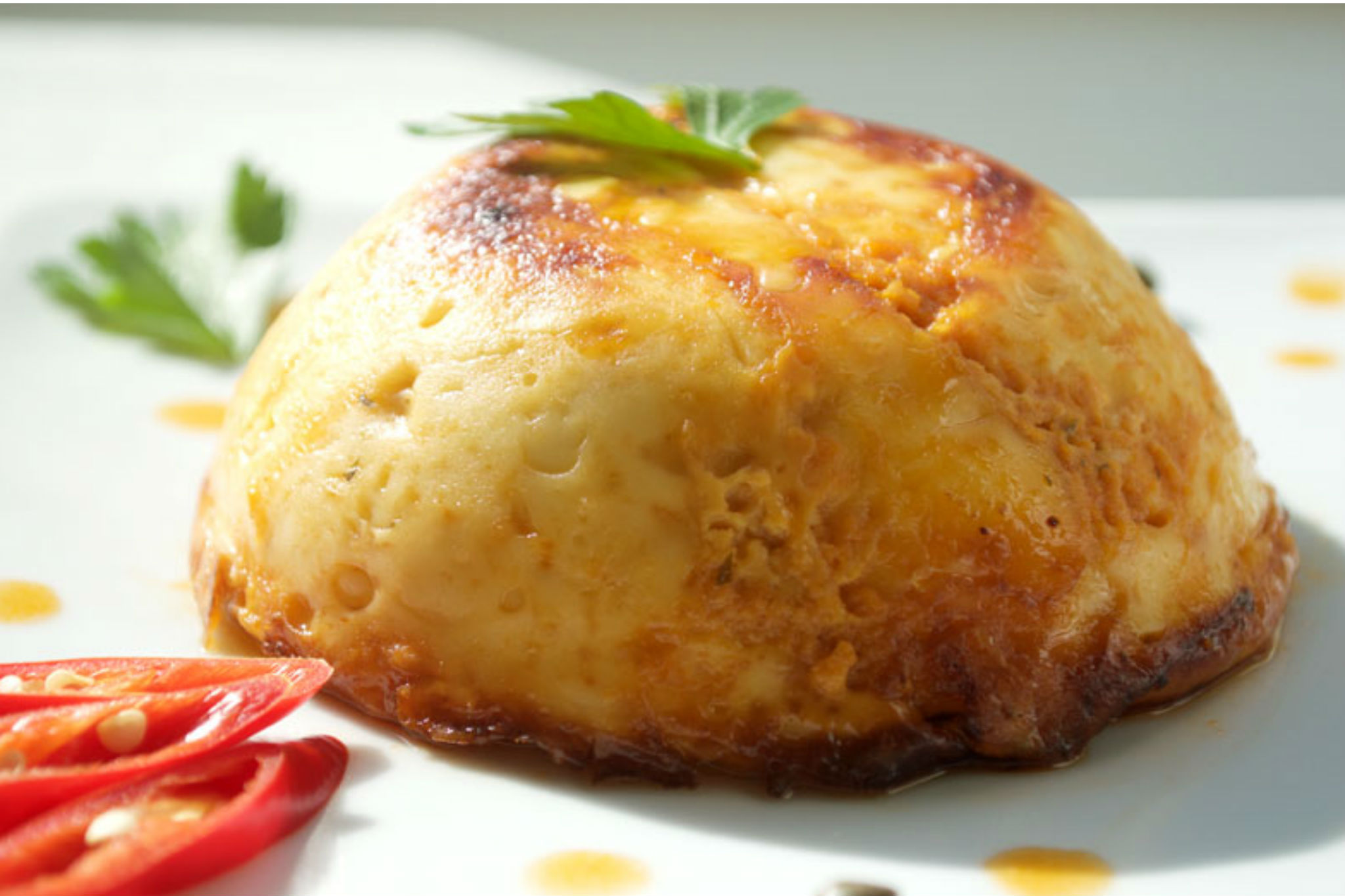 Keshi Yena: Curaçao Stuffed Cheese Casserole Recipe - Drop