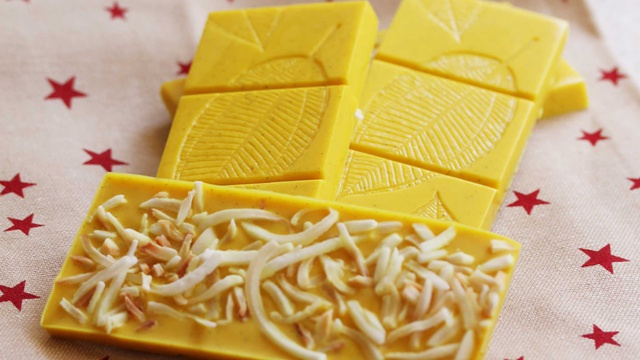 Golden Turmeric Latte Chocolate Bars are bright yellow with shredded coconut on top