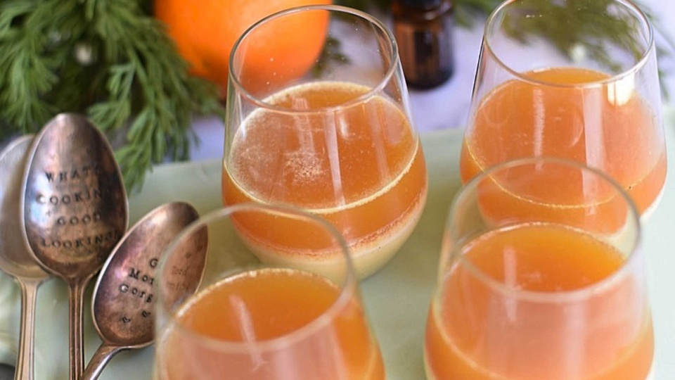 Two toned vanilla and orange dessert cups are served chilled in glasses to reveal both layers