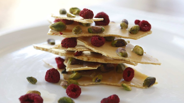 Thin layers of caramelised white chocolate bark pistachios and dried raspberries