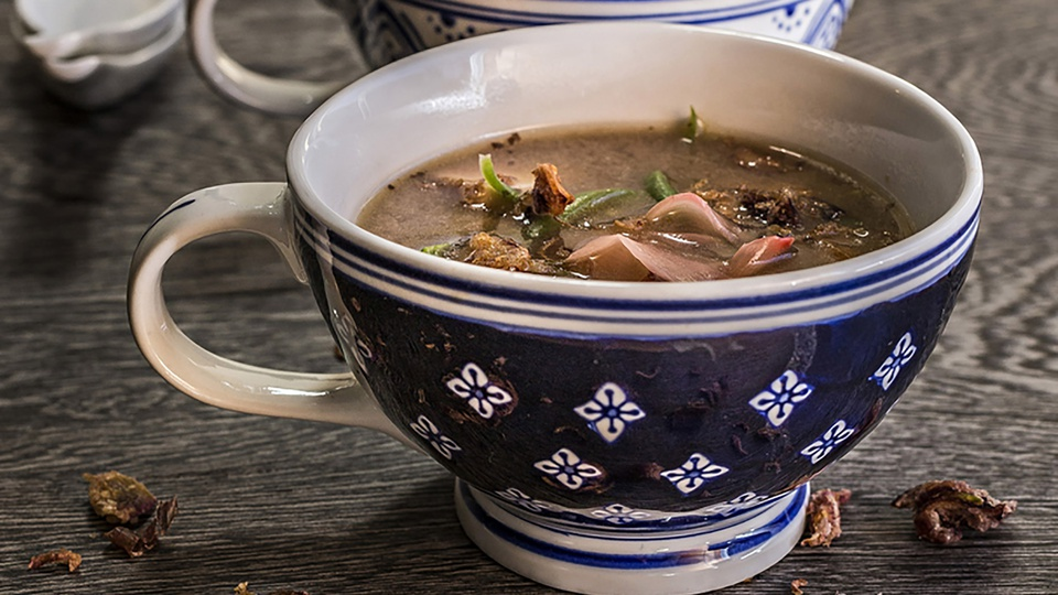 Savoury dulse and miso soup served in an ornate blue china mug