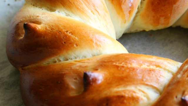 Pale golden twist of lacquered Swiss butter bread