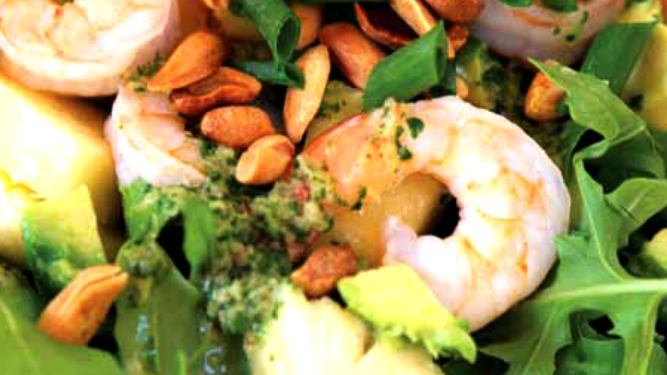 Closeup of prawn peanut pineapple salad with avocado and herby dressing