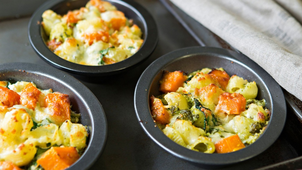 Small ramekins of baked pasta with pumpkin spinach and ricotta are served individually
