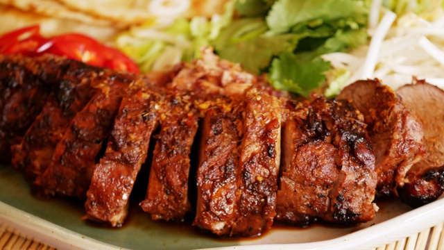 Sliced fillet of moist brown and blackened char siu pork