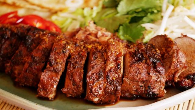 Sliced fillet of moist brown and blackened char siu pork