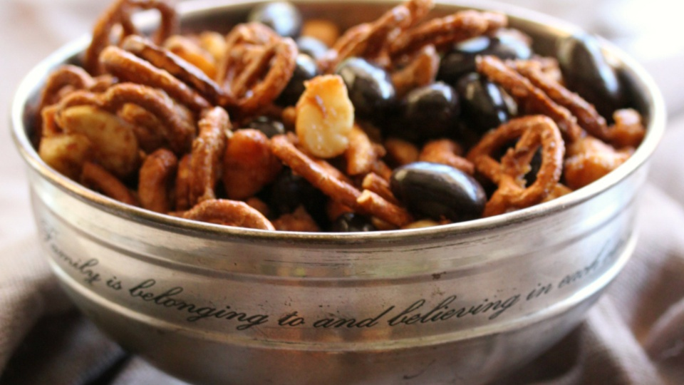 Inscribed silver bowl of festive nut chocolate and pretzel mix