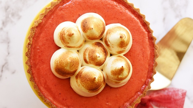 Bird's eye view of strawberry rose pie with piped circles of toasted meringue